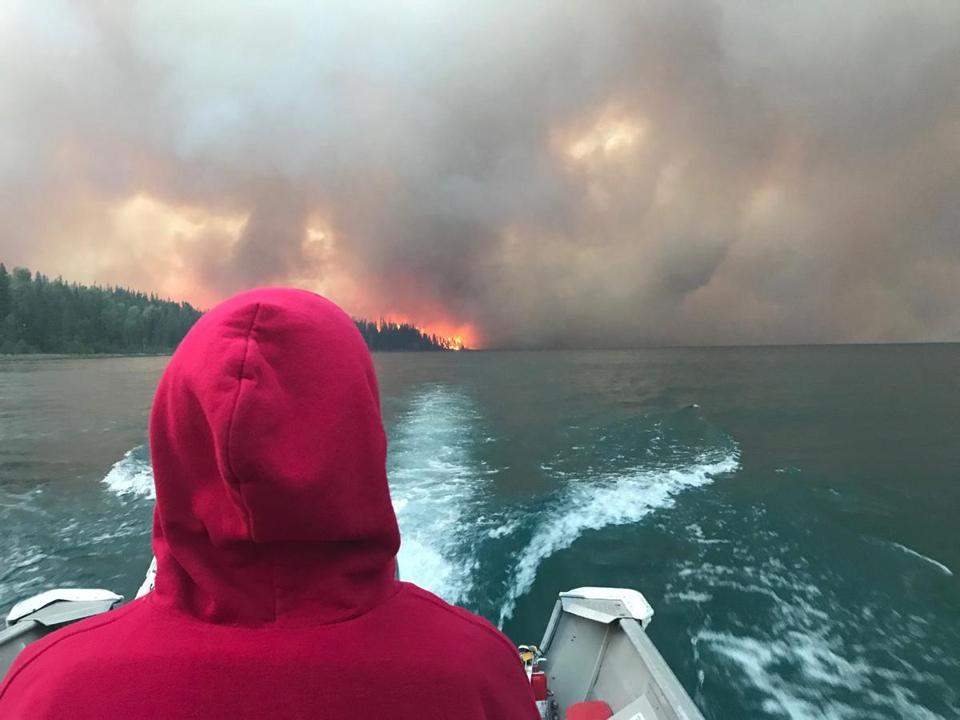 Justin Bilton lookied out at the wildfire from the safety of a boat.